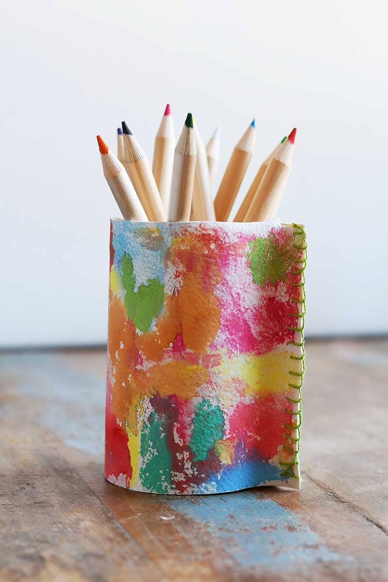 Upcycled tin can into a rainbow leather pen pot