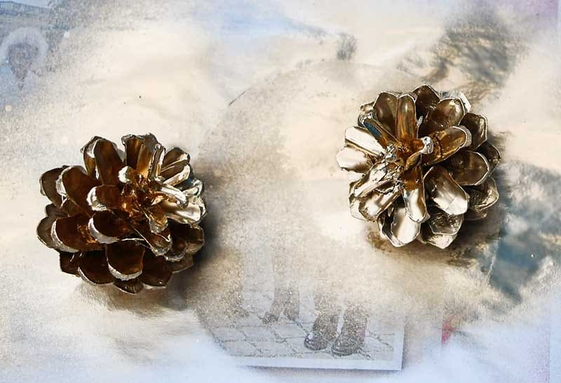 spray painted pine cones gold