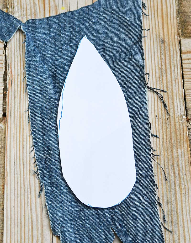 Feather template on denim scrap