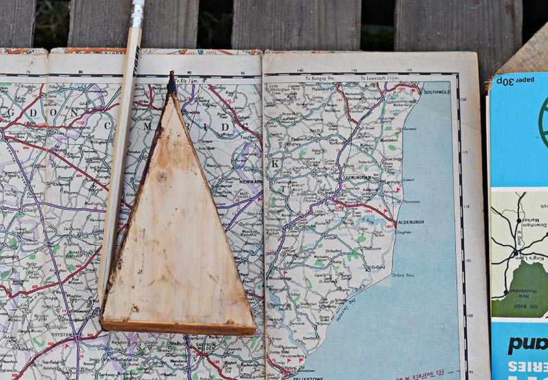Marking road map with wood template