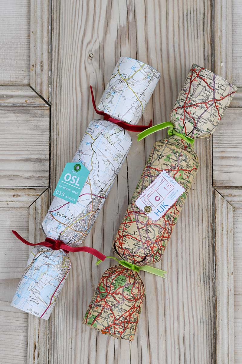 Handmade Christmas crackers from vintage road maps