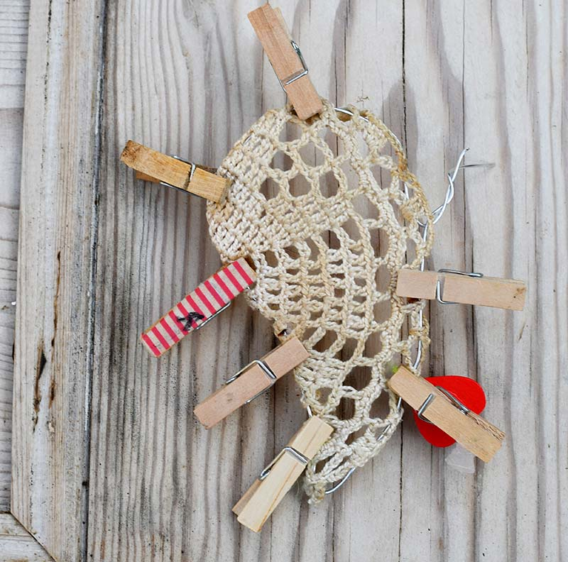 Holding doily in place with pegs