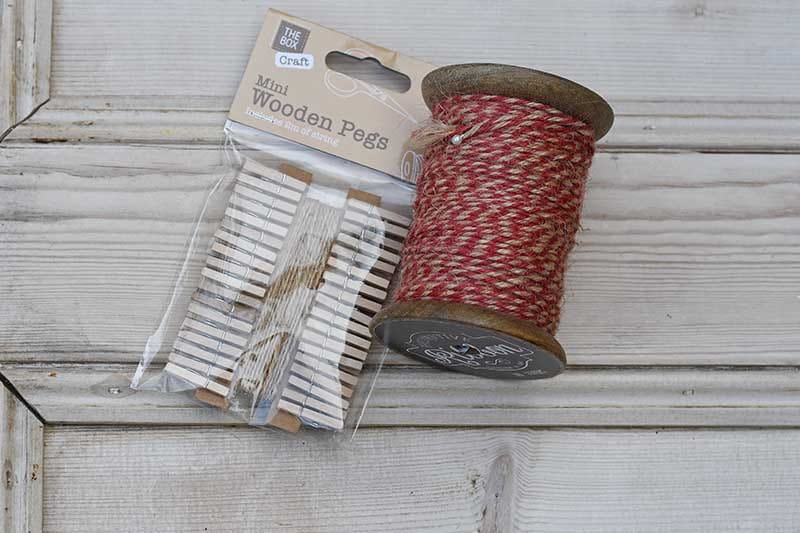 twine and wooden pegs