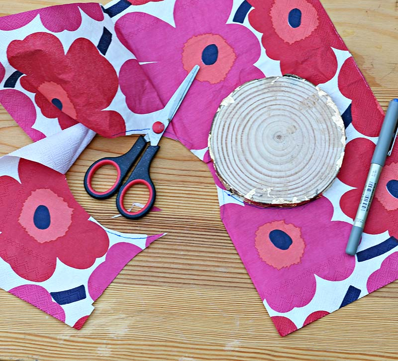 Cutting Marimekko napkin for decoupage.