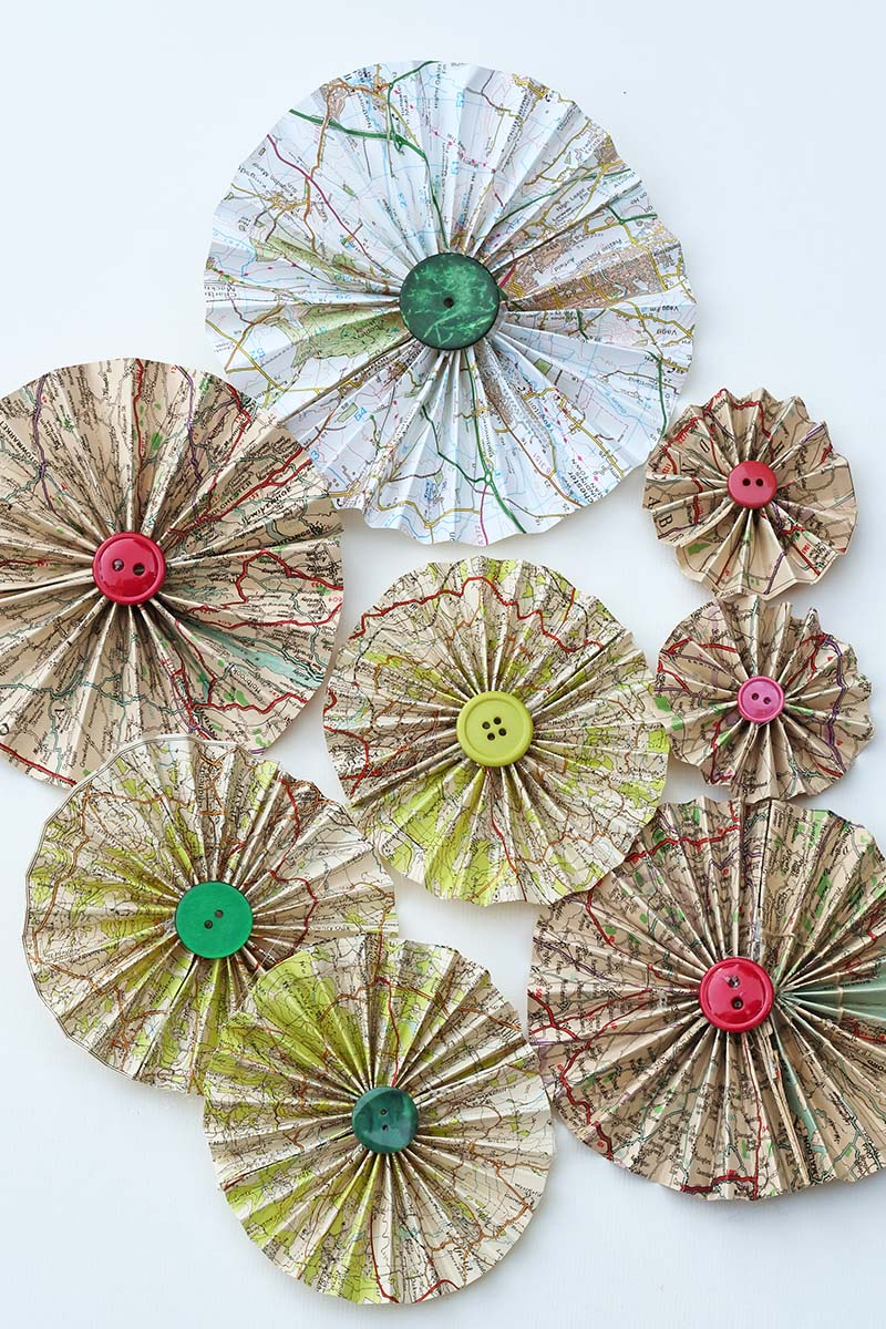 Upcycled road map rosettes