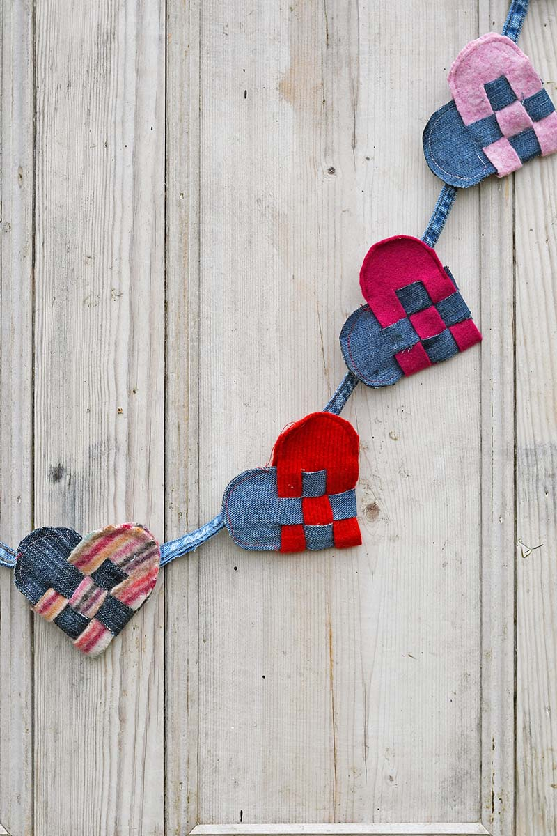 Scandinavian woven hearts garland hung on the door.