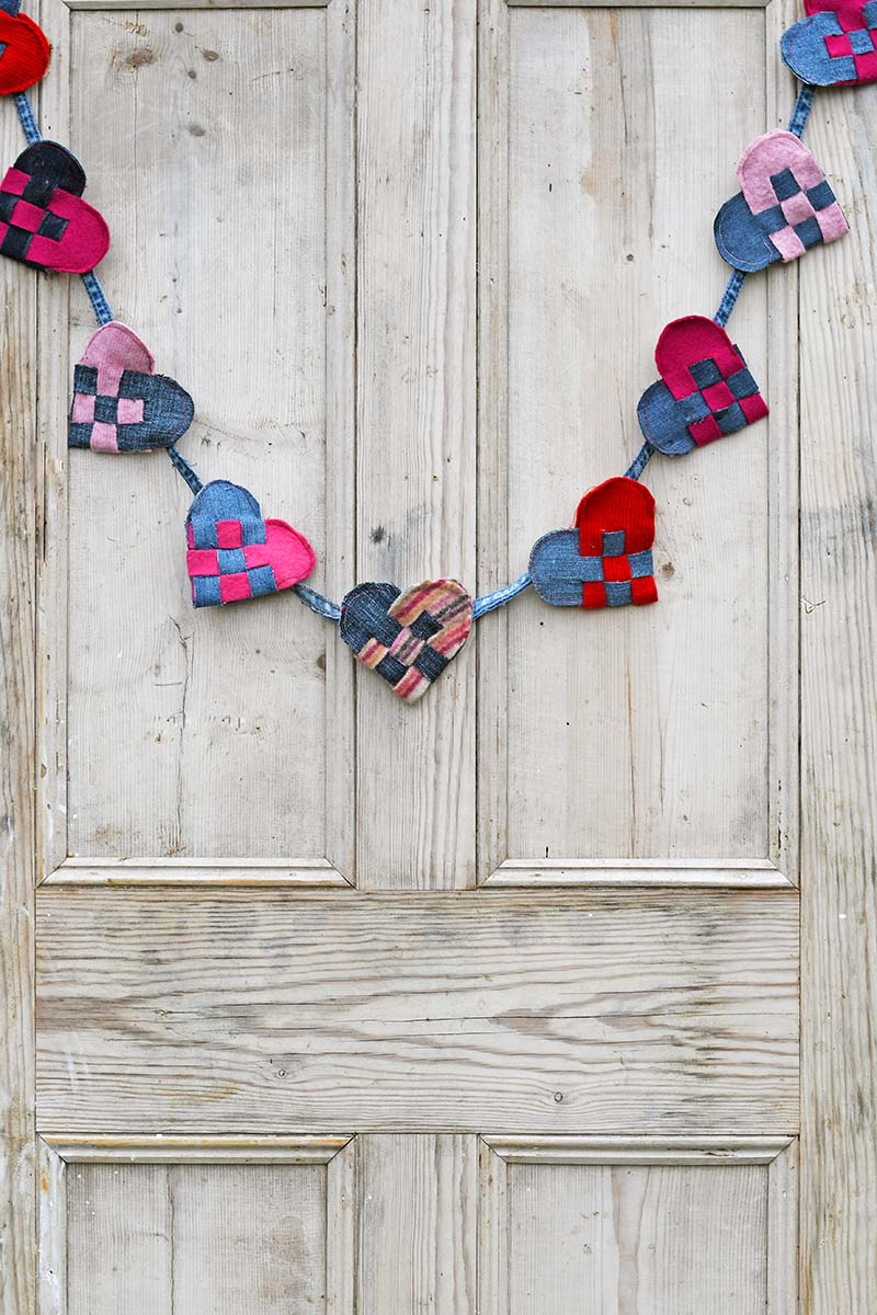 Upcycled denim and felt woven Scandinavian hearts on door.