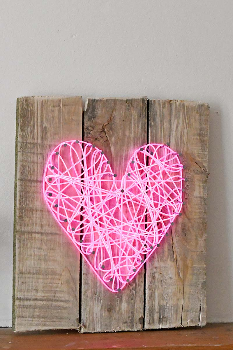 Neon heart sign made with el wire string art