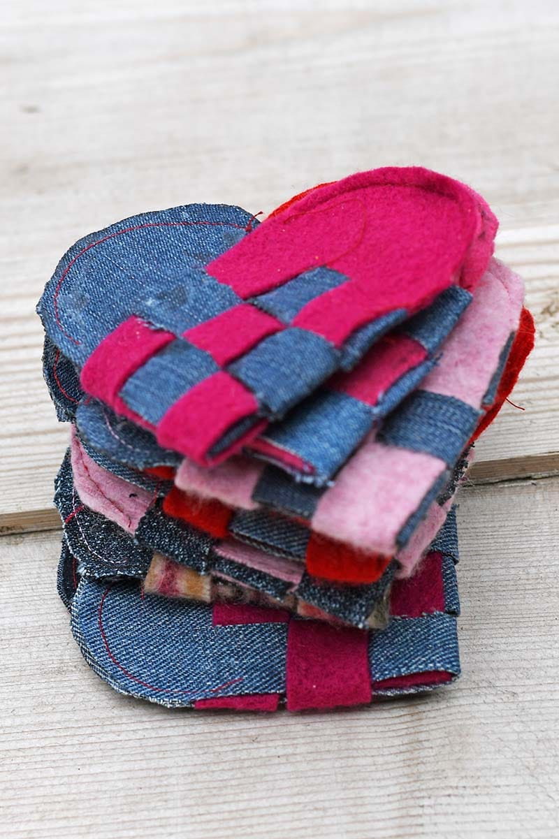 A stack of woven hearts for a Scandinavian garland for Valentine's day.