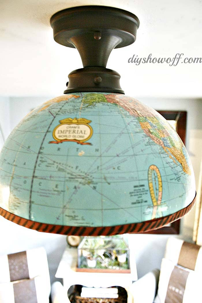 Upcycled lighting with a world globe