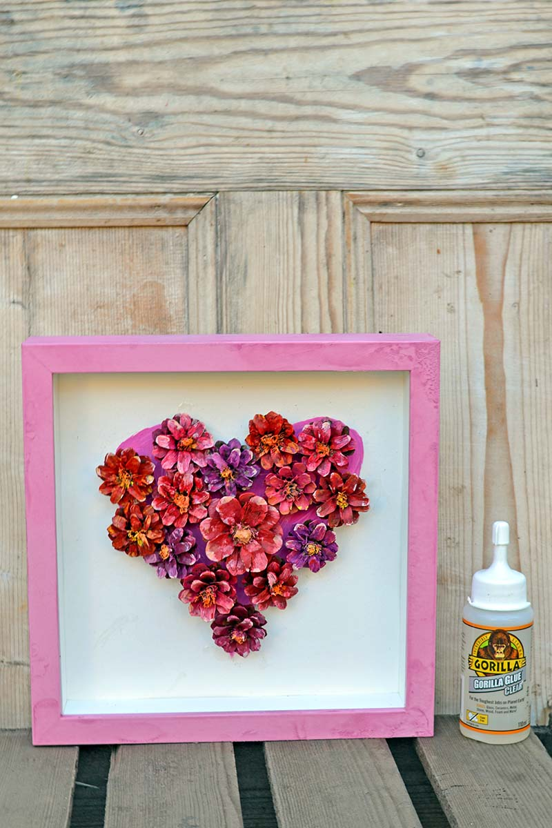 DIY painted pinecone flower heart display made with Gorilla Glue Clear