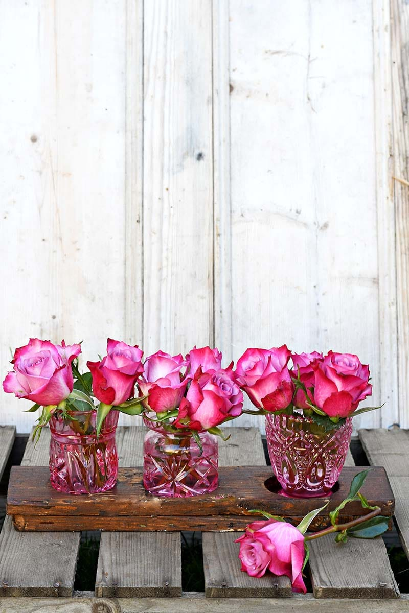 Hand painted coloured glass bud vases