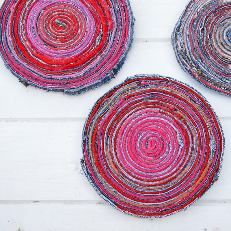 Upcycled fabric placemats made with denim and wool scraps.