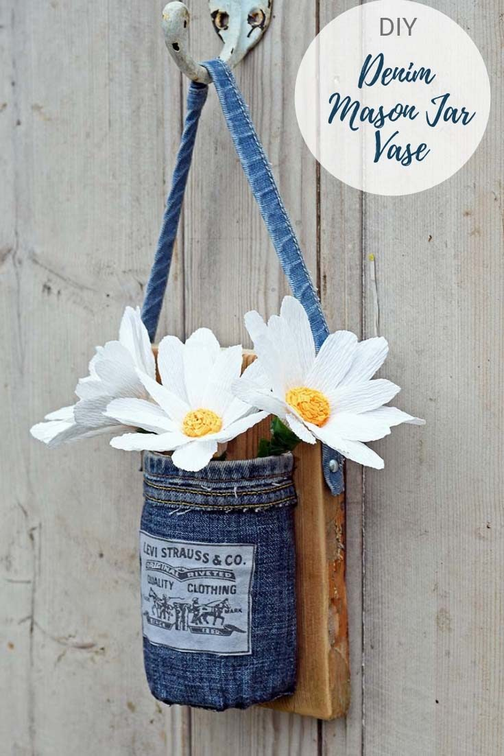 Whatever your decor style, farmhouse, rustic or Boho a denim hanging Mason jar vase will look fabulous. Simple step by step tutorial. #denim #levijeans #upcycledjeans