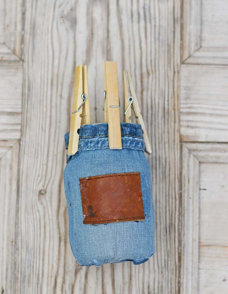 gluing  the denim to the paper mason jar vase
