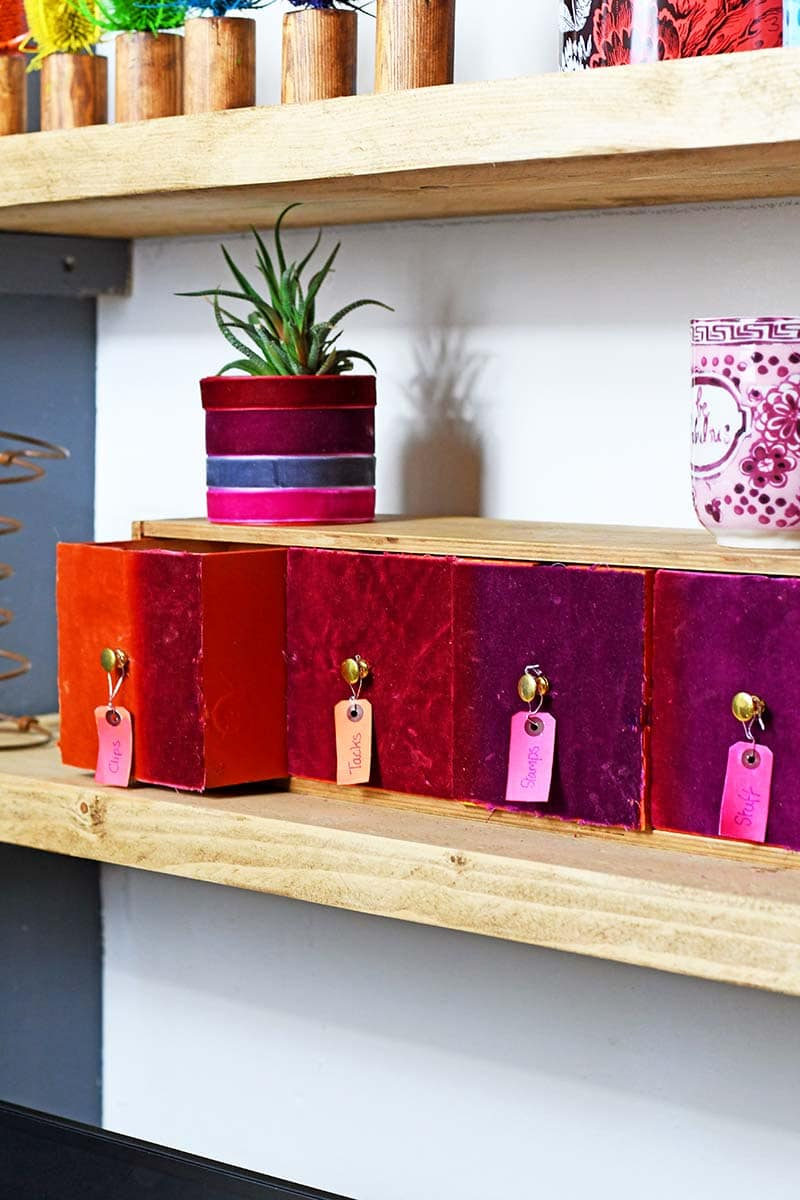 Velvet small wooden drawers on shelf