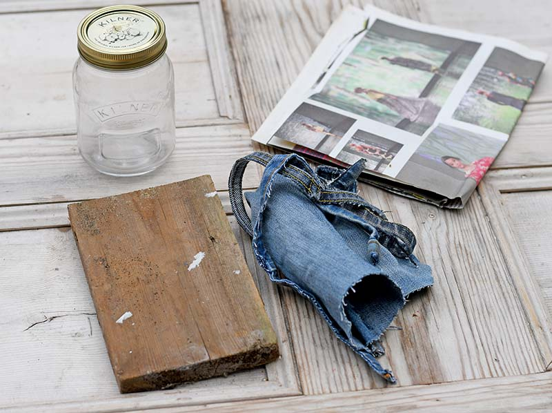 mason jar, wood, denim scraps and newspaper