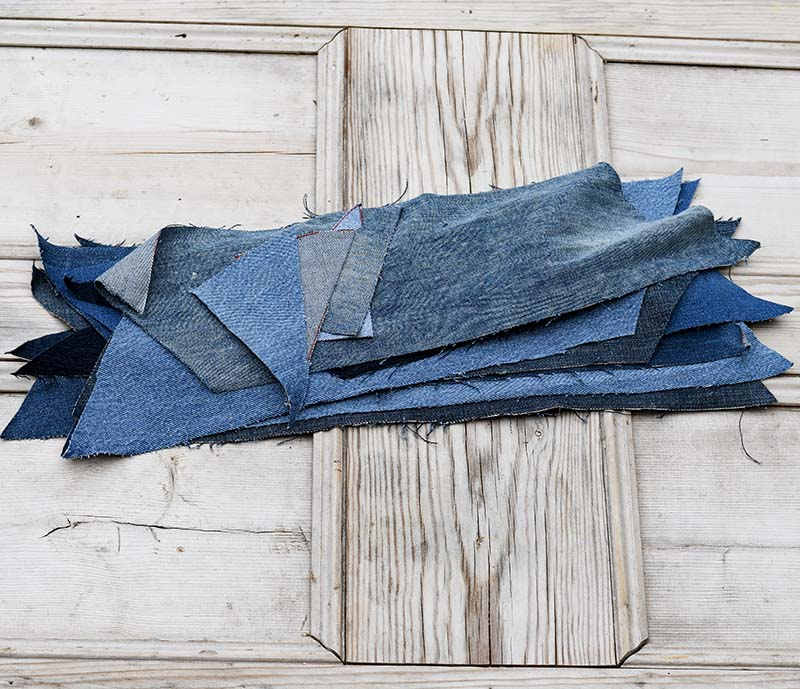 Cut denim chevron pieces for handmade rug