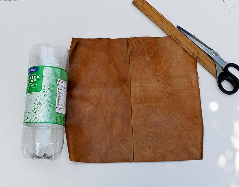 Cutting the leather for the DIY boho vase
