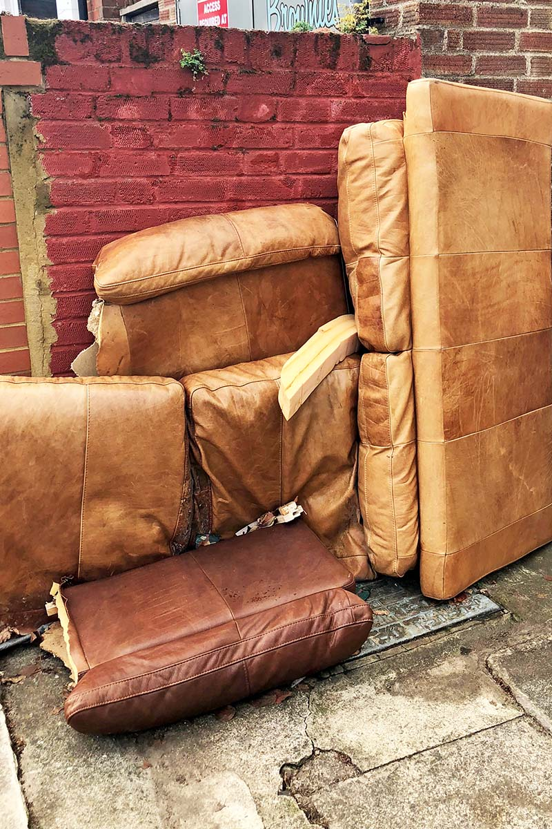 Discarded sofa source of leather