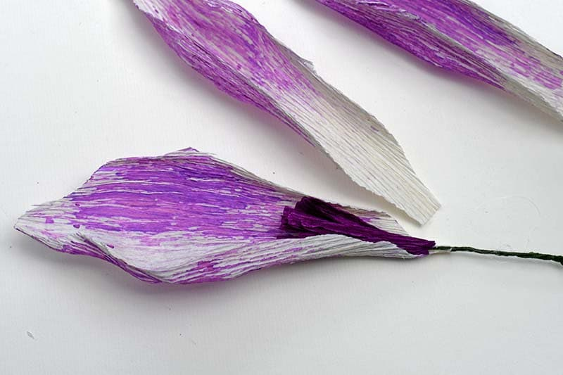 Adding the first petal to the boho crepe paper flower