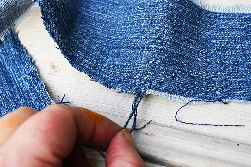 fraying denim by pulling threads