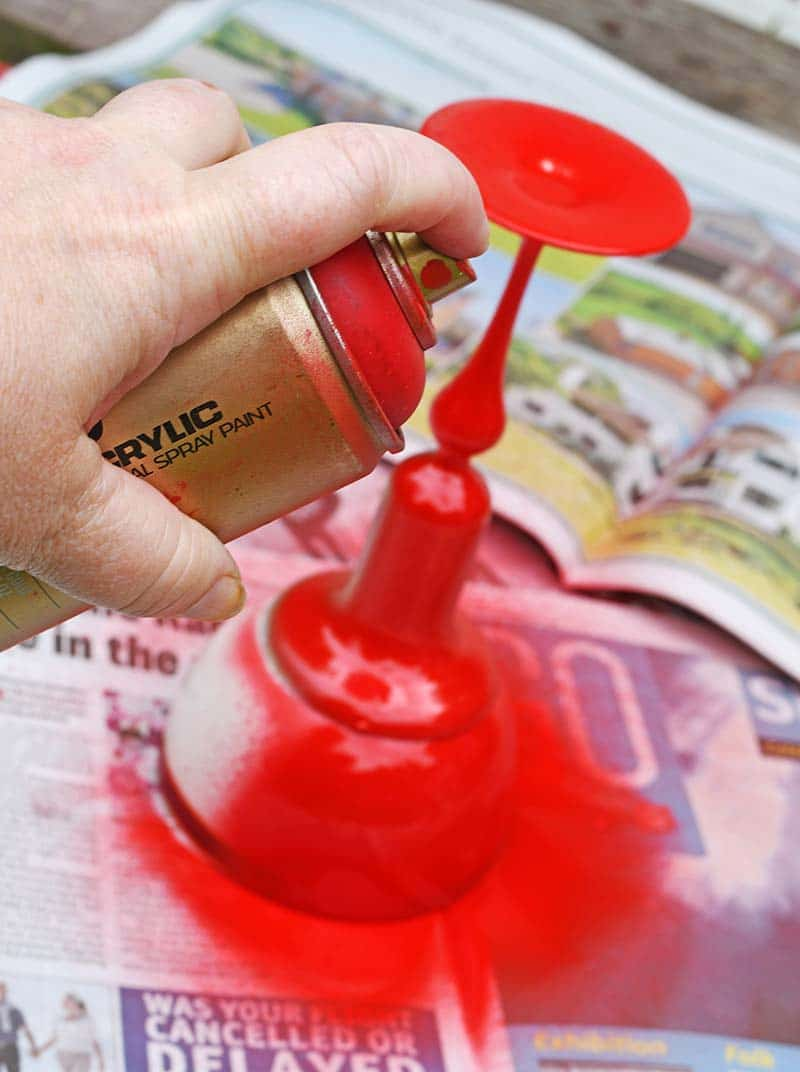 spray painting planter red