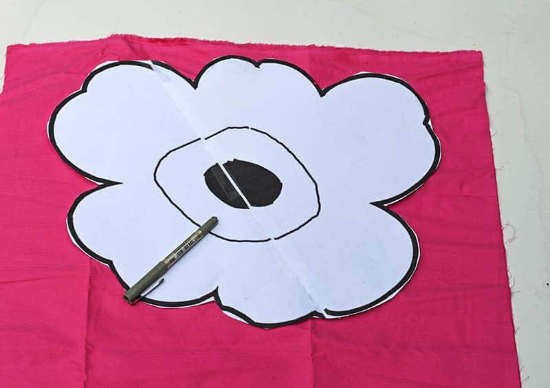 cutting out Unikko poppy pattern