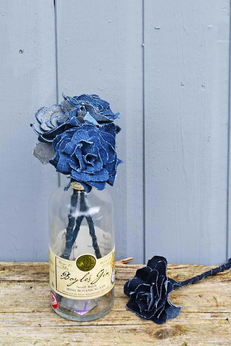 Denim flowers in gin bottle