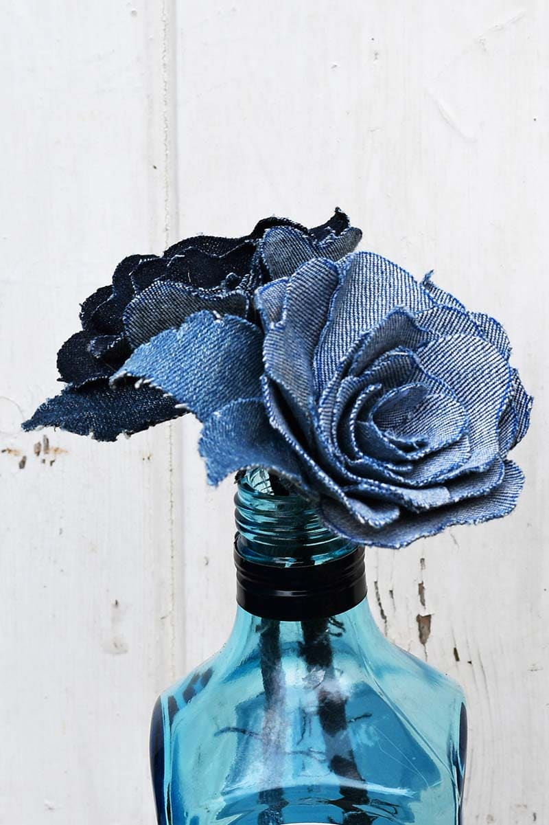 Denim roses in Bombay saphire bottle