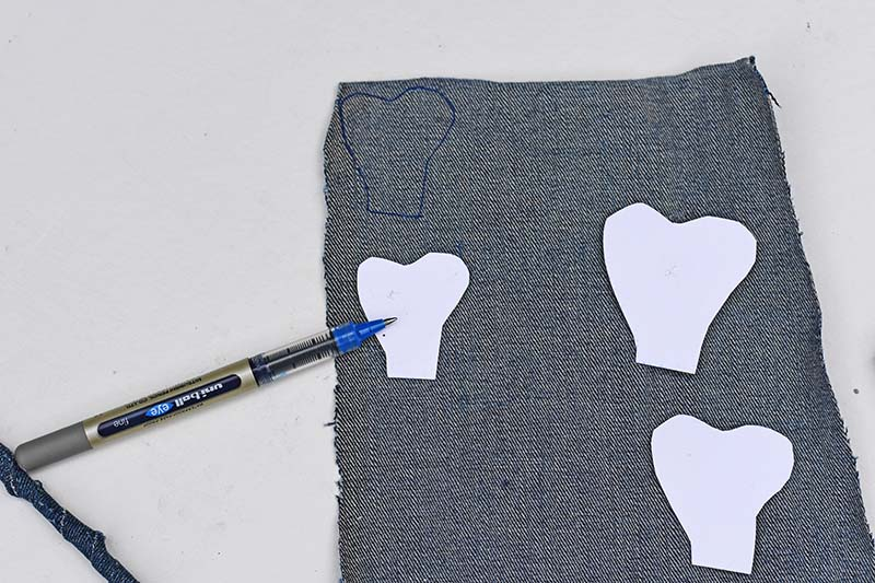 Drawing around and cutting out denim petals