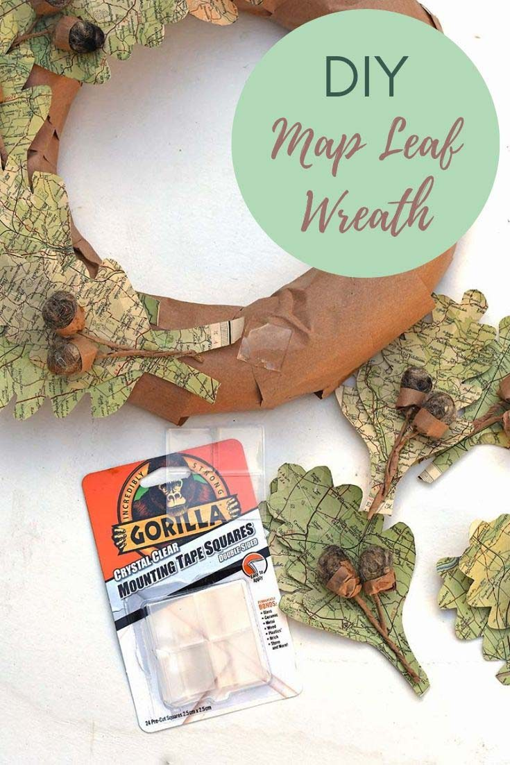 For some unique fall decor for your home, repurpose some old road maps into a stunning paper leaf wreath. Full step by step instructions. #fallwreath #leafwreath