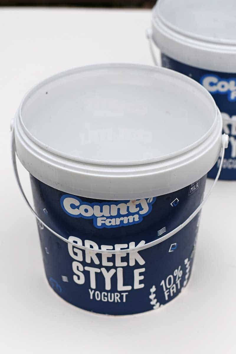 empty Greek yogurt bucket