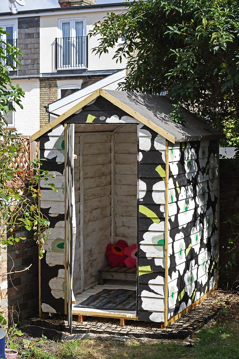 Painting a shed with colour and pattern