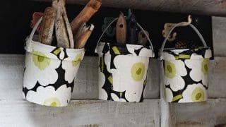 hanging upcycled Marimekko buckets