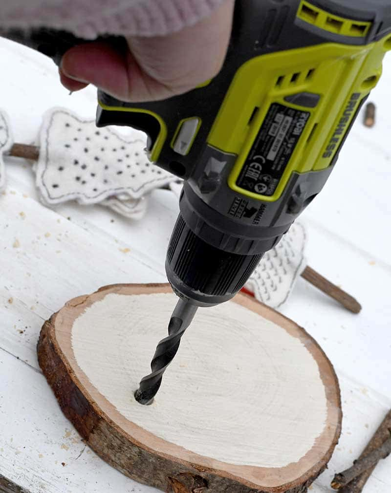 Drilling hole in wood slice