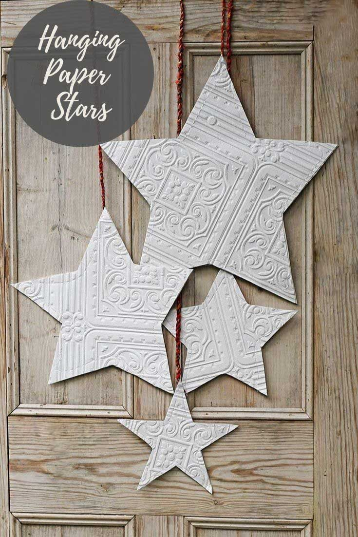 How to make paper stars from textured wallpaper, for a unique and affordable Christmas decoration. Hang them from your doors and walls for a festive look. #papercraft #christmascraft