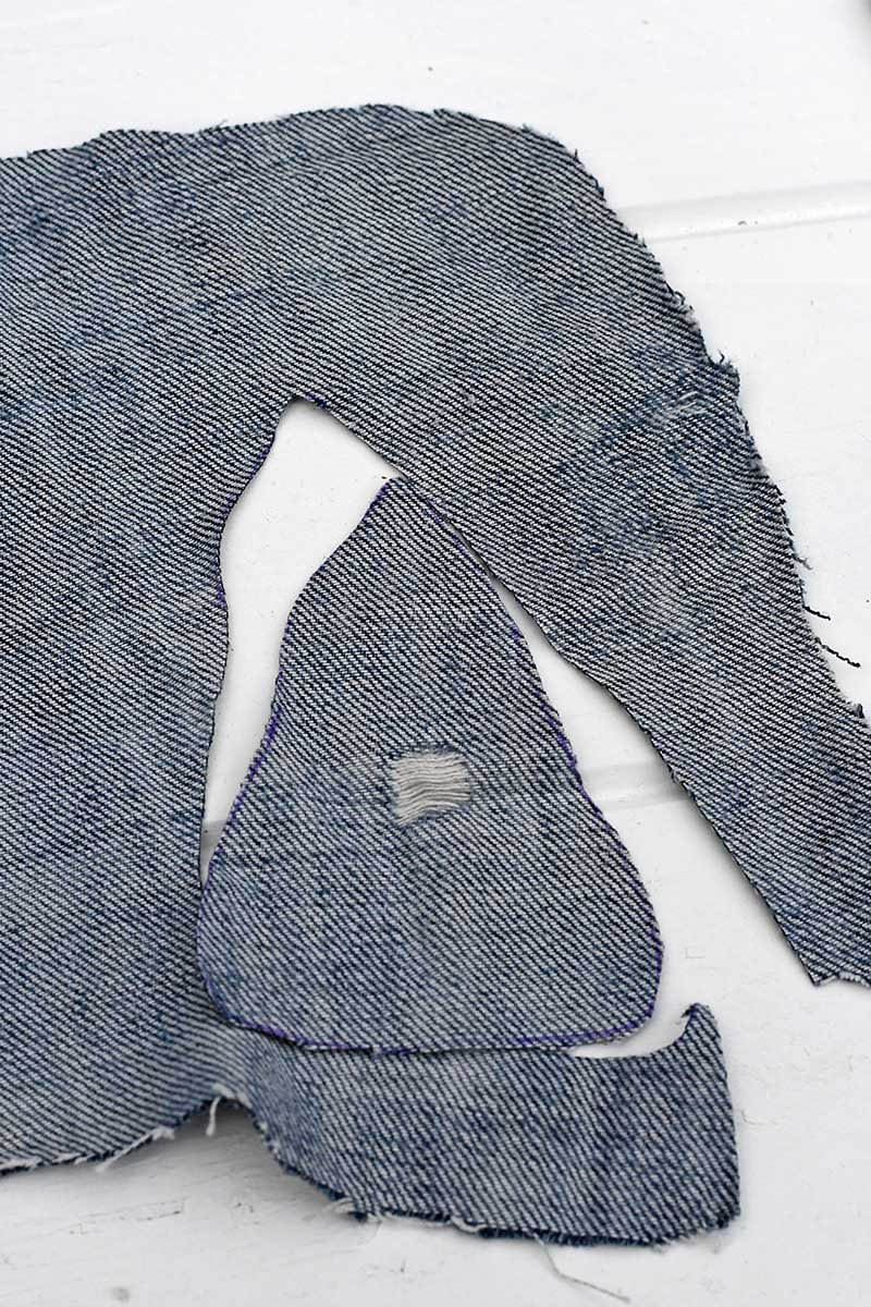 cutting out the denim shape