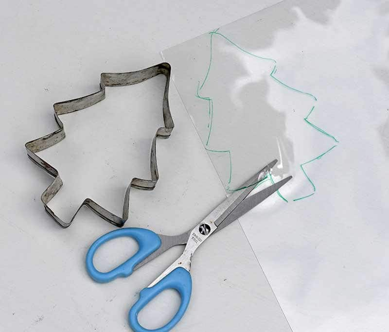 cutting the shape out of shrink plastic.