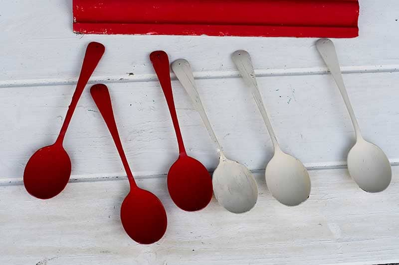 Painted red and cream spoons