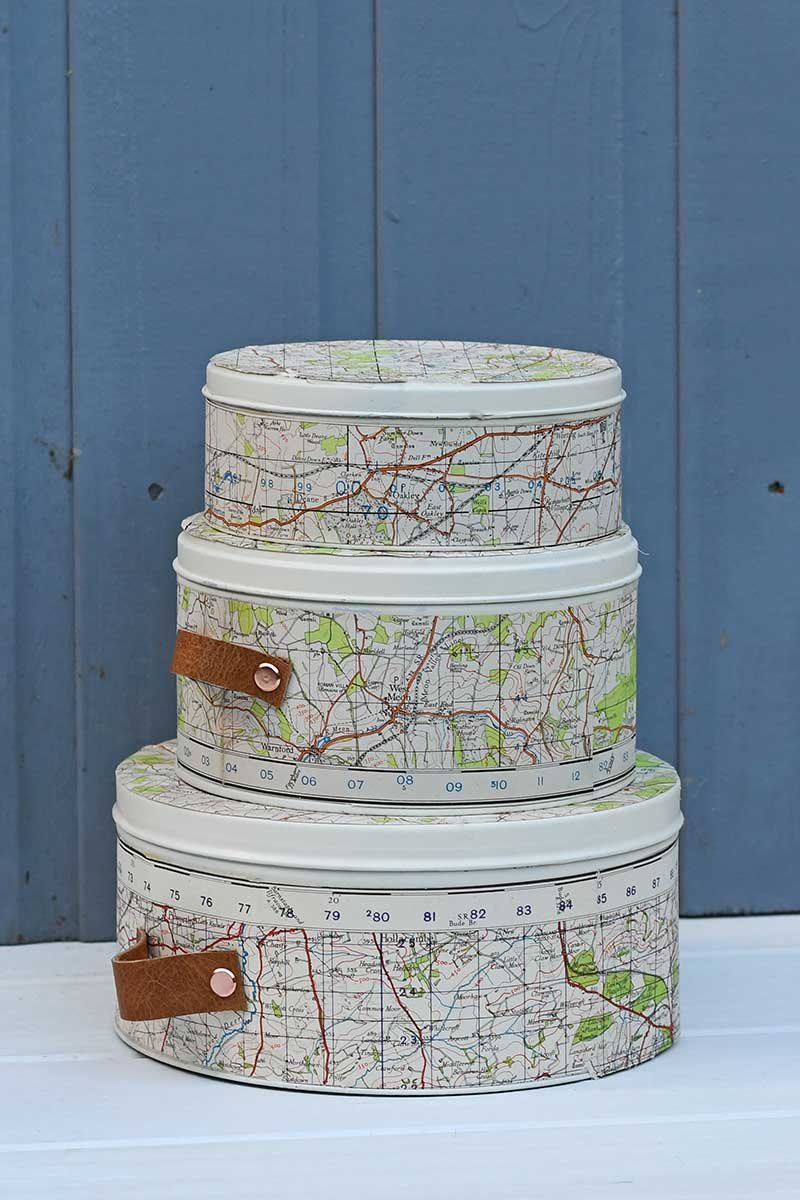 empty cookie tins upcycled with maps