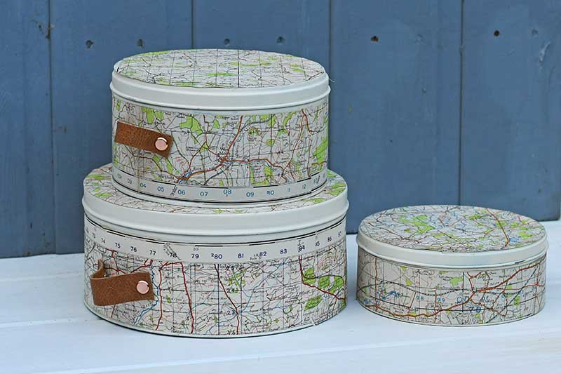 Repurposed map cookie tins