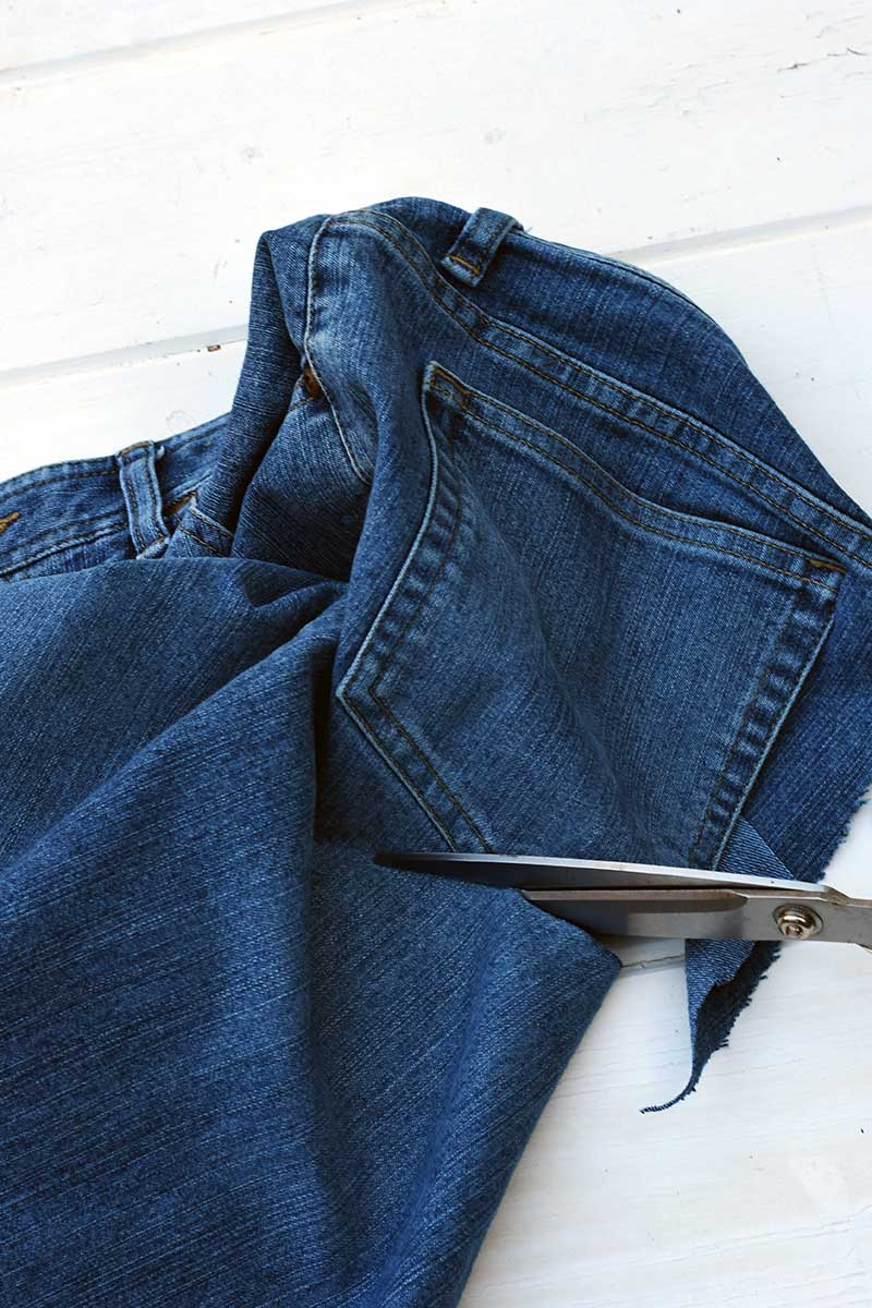 cutting out a back pocket with scissors.