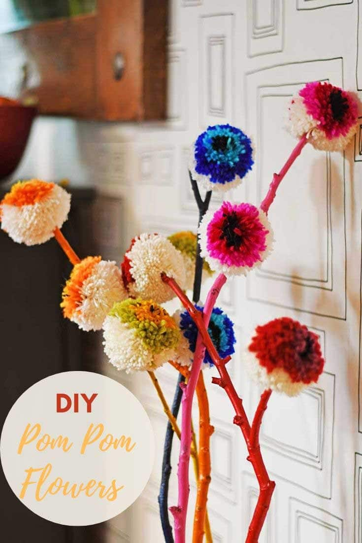 How to make Marimekko inspired rainbow DIY pom pom flowers.  A great yarn/wool stash buster and a lovely way to brighten up your home decor.