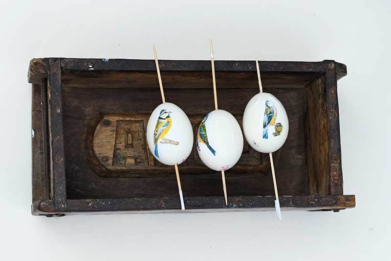 Decoupage eggs drying