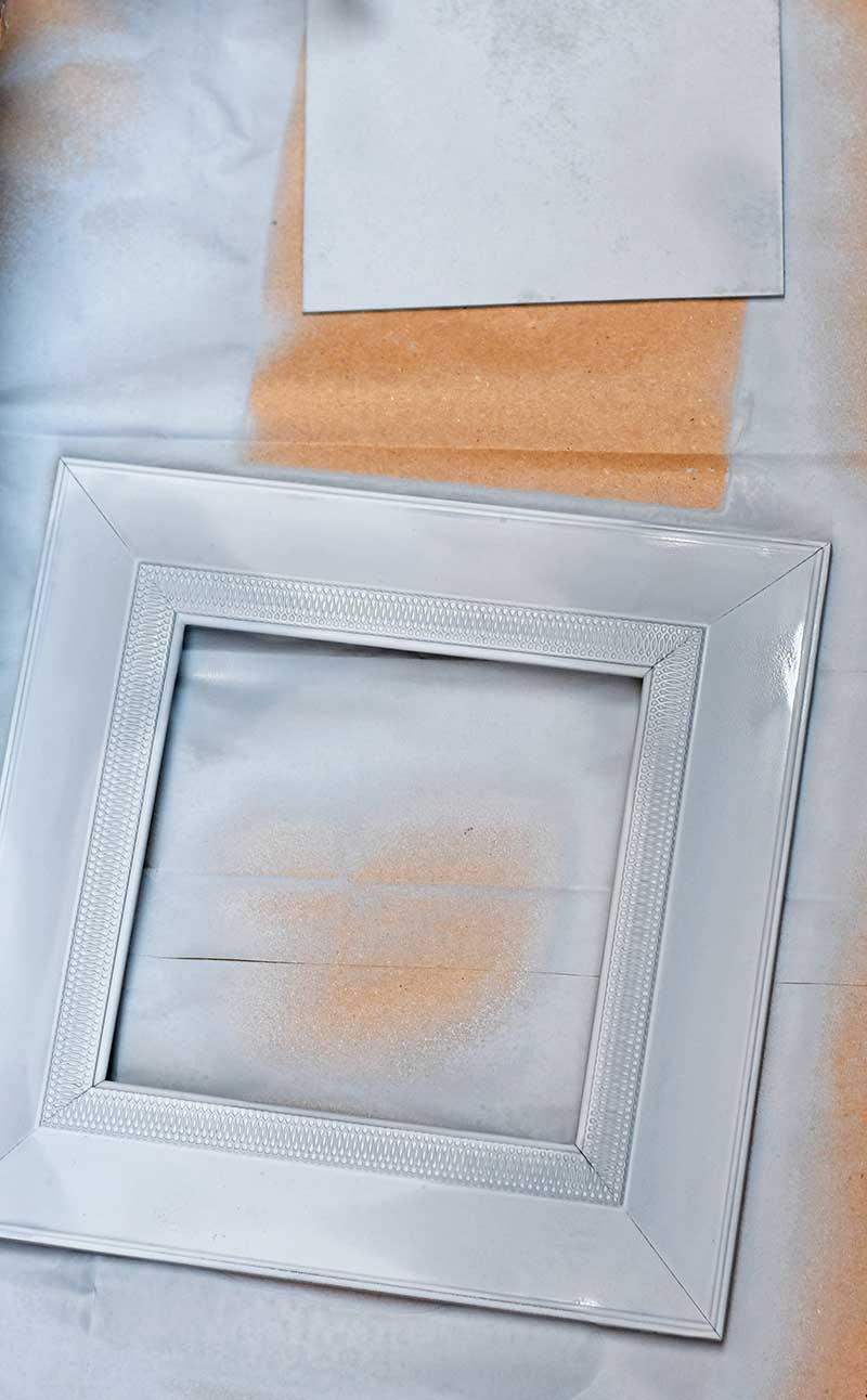Spray painting frame and board.