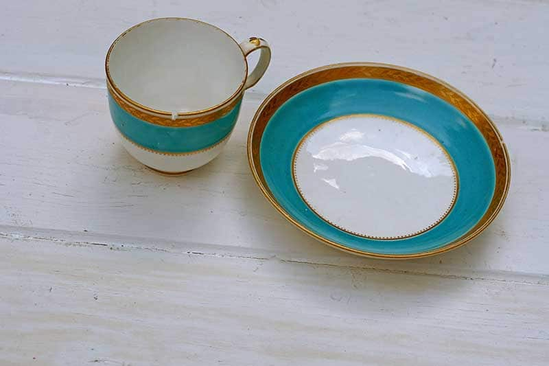 Chipped cup and saucer