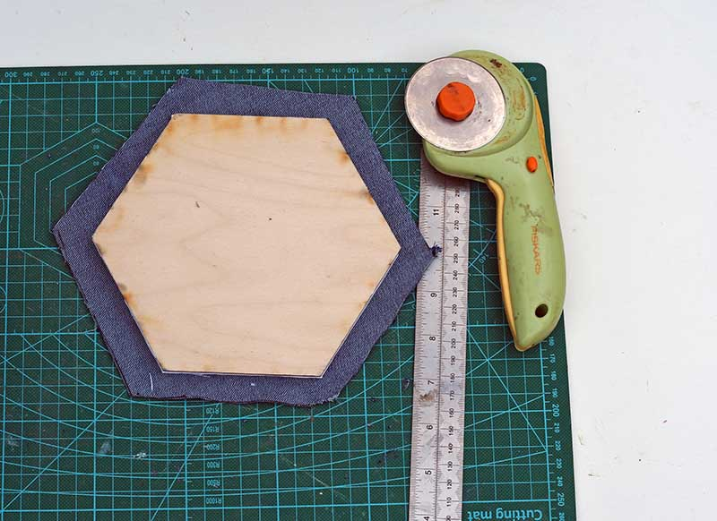 cutting out denim hexagons