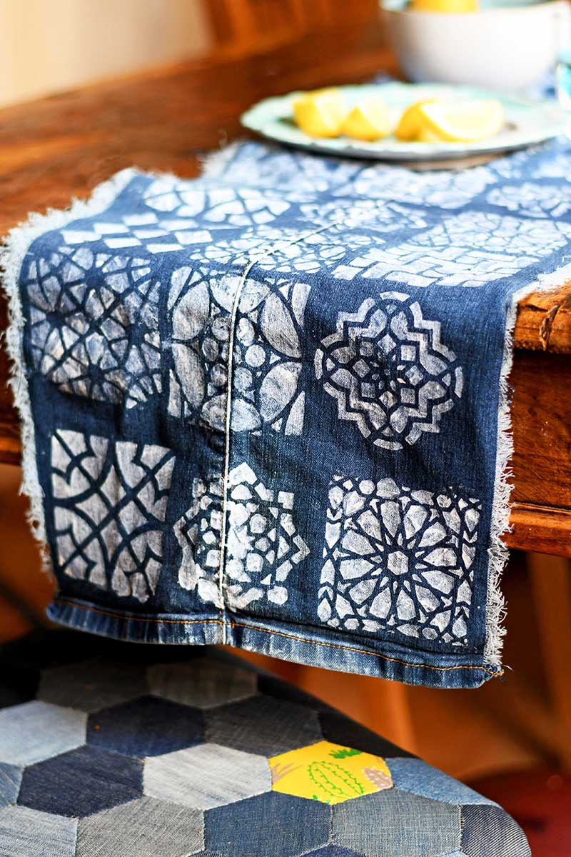 Denim table runner and patchwork chairs