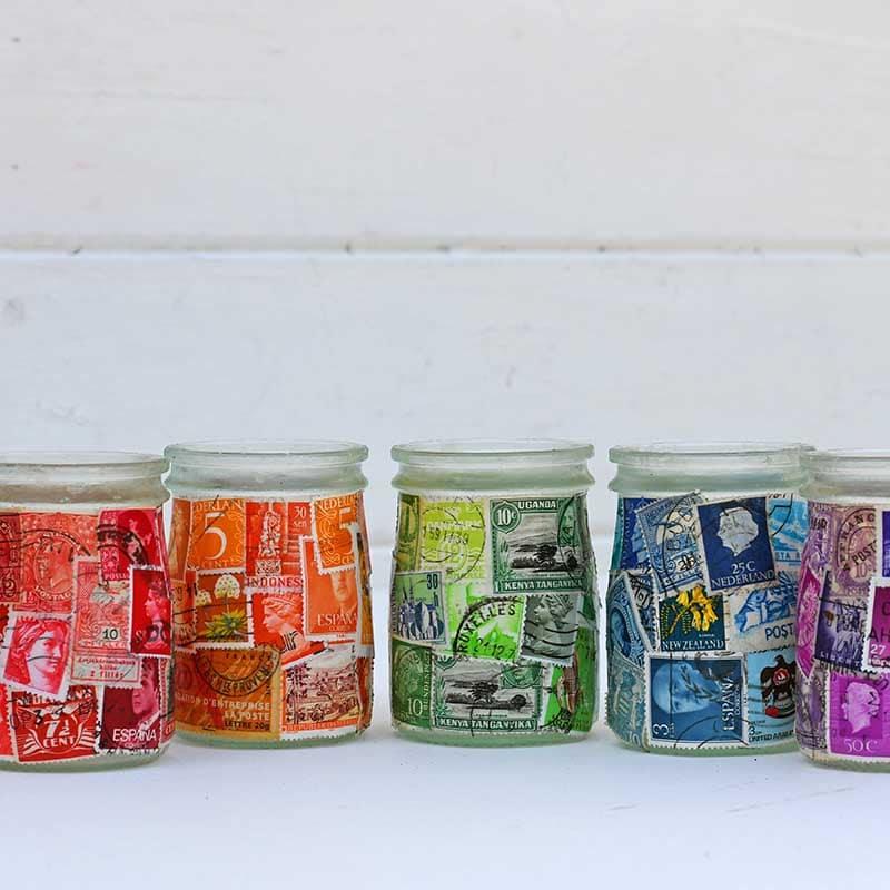 A rainbow of postage stamp decoupage jars